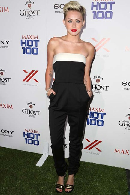 Miley Cyrus taps into another hot-ticket trend, the jumpsuit, in Valentino at a Hollywood party.