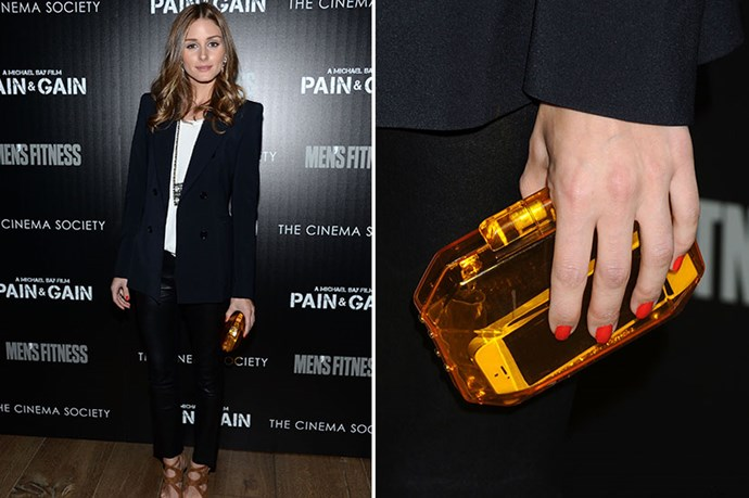 Olivia Palermo's clutch is the perfect shade of amber. Go for a colourful clutch to bring instant zing to a neutral outfit.