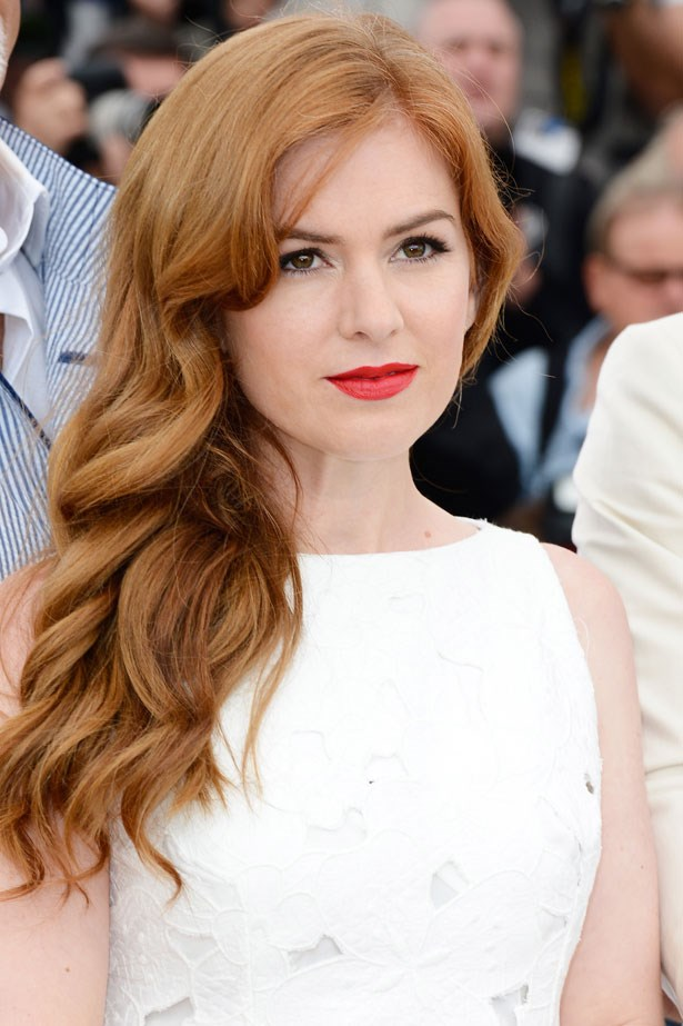 Soft, floaty waves and a soft ginger shade flatter Isla Fisher's porcelain complexion.