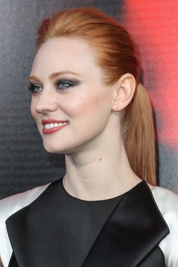 She plays a feisty newbie vampire on <em>True Blood</em>, but Deborah Ann Woll's matching brows and tonal lip and cheek shades make the glossy orange more ladylike.