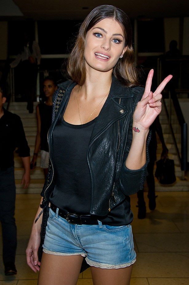 Model Isabeli Fontana shows off a pair of lace-trimmed denim shorts with a classic black jacket and tank. Consider it the perfect lesson in chic French dressing.