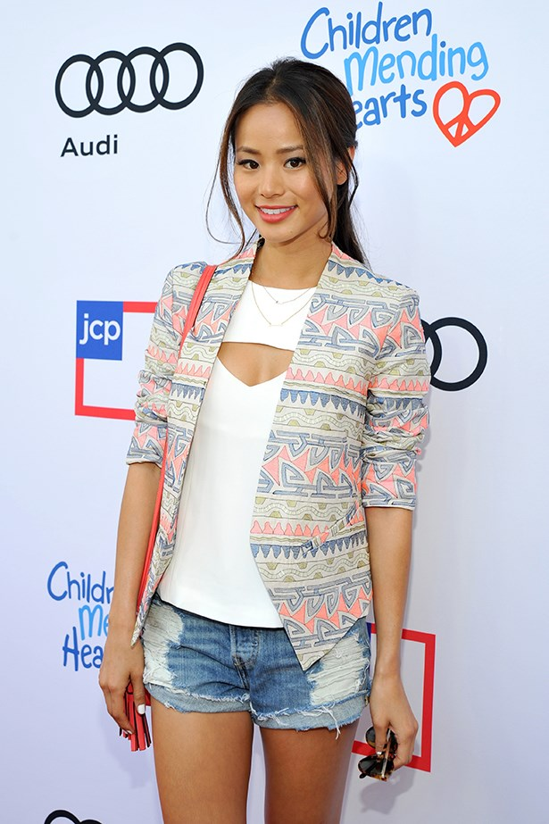 Jamie Chung proves denim can be dressed up with a tailored blazer and rolled-up sleeves.