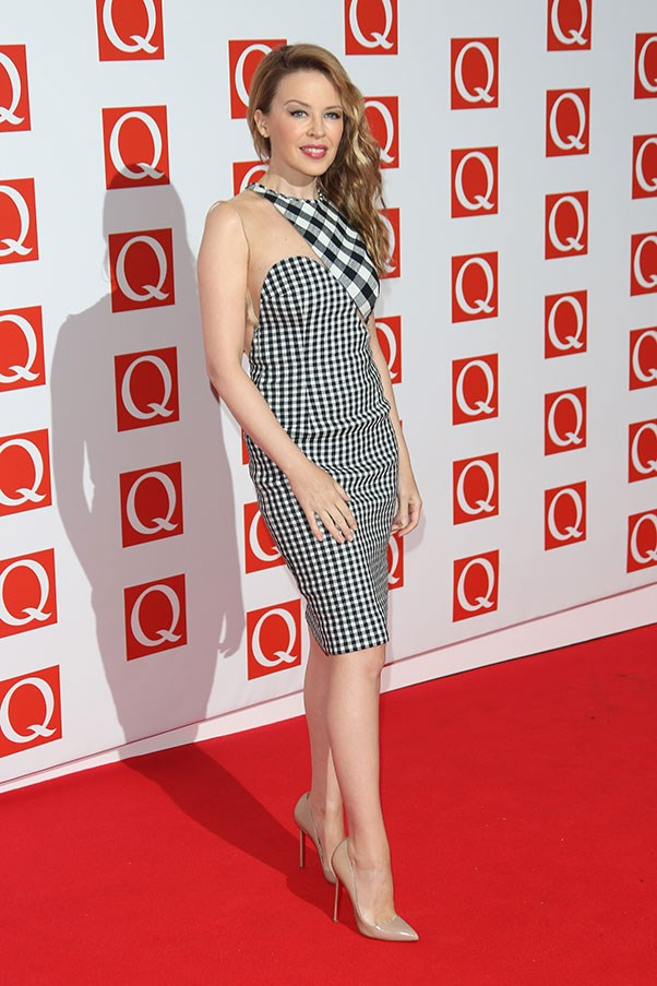 Kylie Minogue gives gingham a go wearing a peek-a-boo Stella McCartney number. Showing a bit of skin is one way to ensure gingham doesn't come off as <em>too</em> twee …