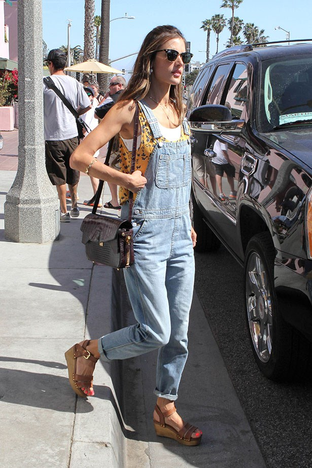 Make like a supermodel and elevate your casual Topshop overalls into the realm of high-fashion cool like Alessandra Ambrosio. Just add an Alexander Wang bag, Ray-Ban sunglasses and some wedge sandals to boot.