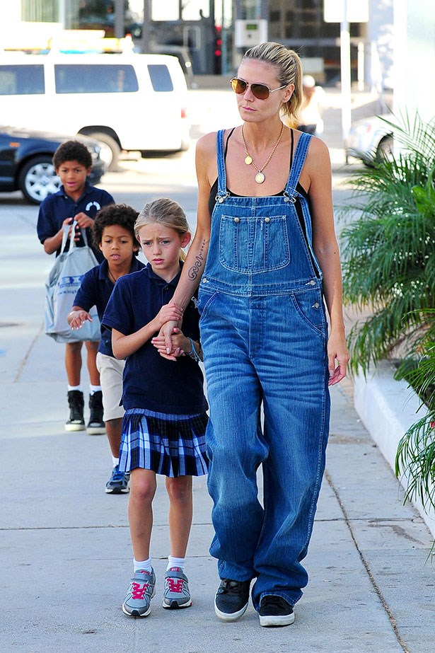 Heidi Klum demonstrates that overalls are, <em>indeed</em>, all grow up. The 40-year-old mum works a pair during a school-run.