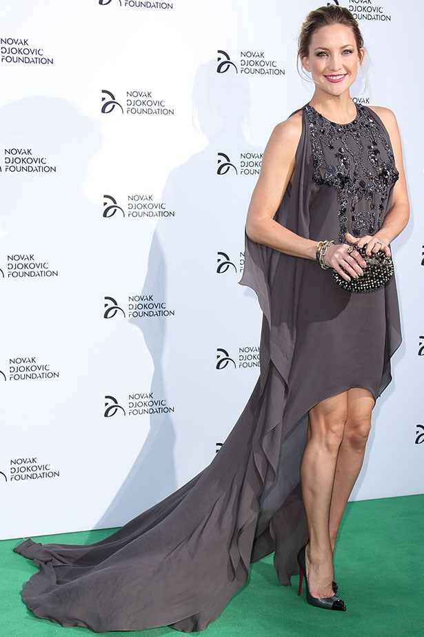 "Kate Hudson is elegant in a billowy Elie Saab dress teamed with Christian Louboutin shoes. The cocoon-shape elevates this ""mullet dress"" into the <em>so</em>-on-trend category."