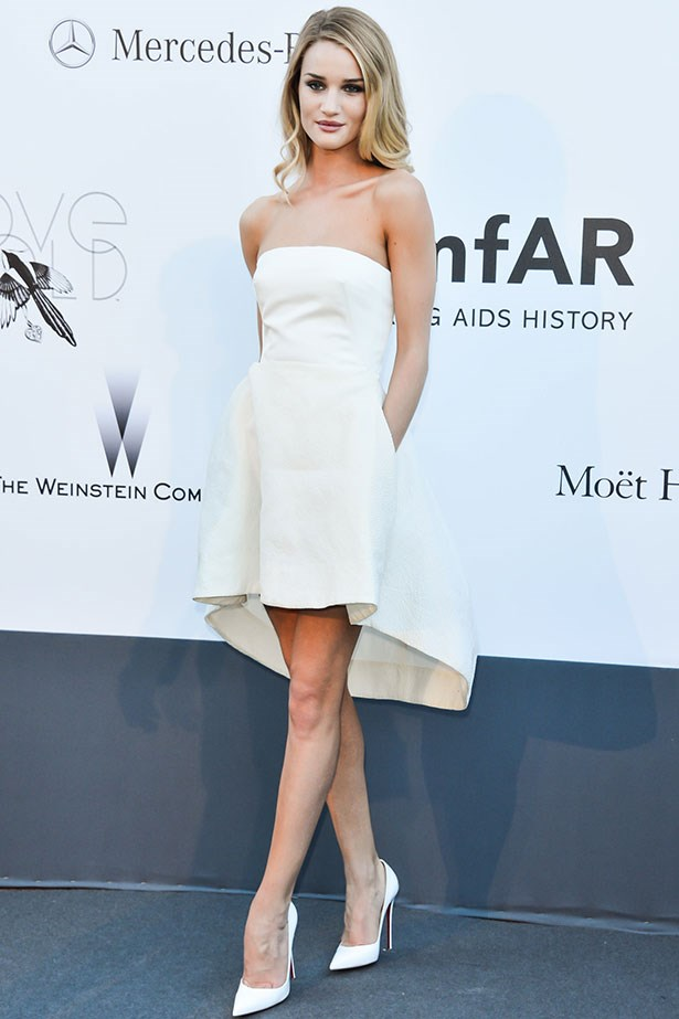 "Rosie Huntington-Whiteley takes a subtle spin on the ""mullet dress"" trend out for a spin in the form of a Dior dress."