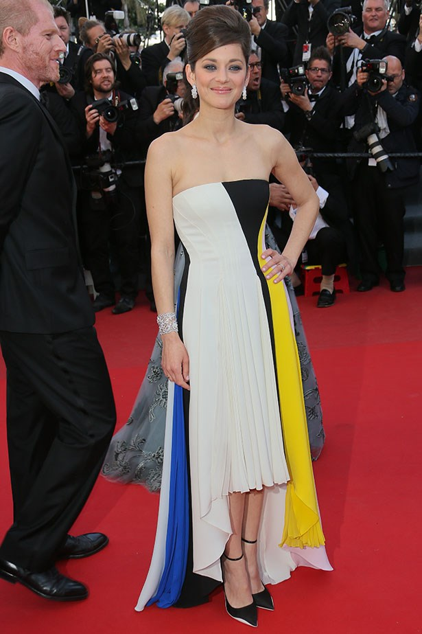 Amidst a sea of black and white gowns, appears Marion Cotillard in this rainbow Dior. The red carpet equivalent of a pot of gold…