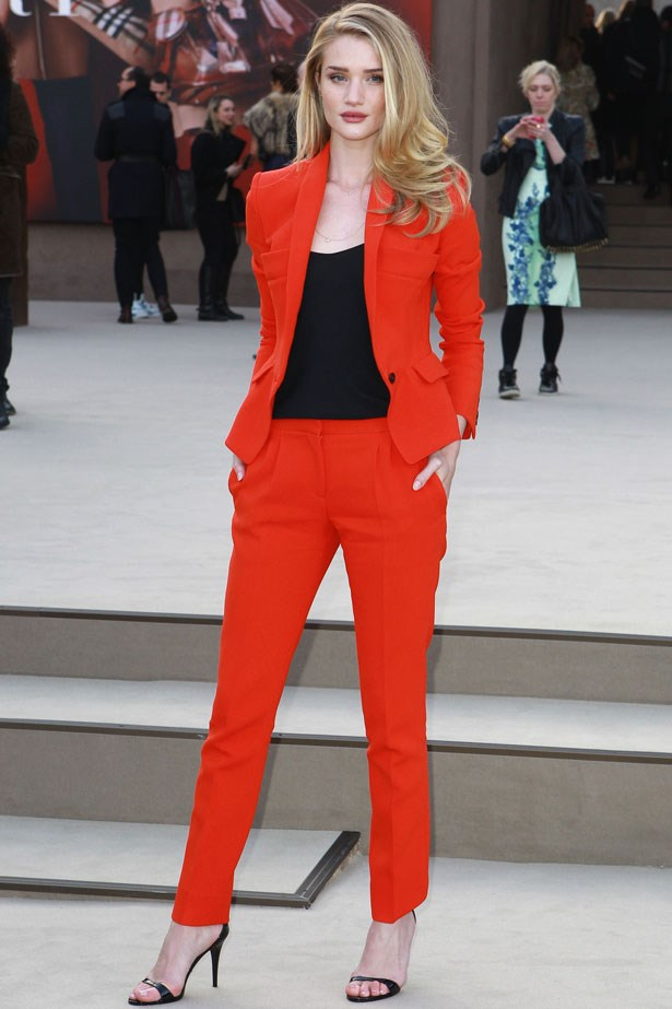 The Burberry darling dares to wear a bold-hued suit by the label to their autumn/winter 13-14 show at London Fashion Week.  She pulls off the masculine look with the help of Manolo Blahnik heels and feminine waves.