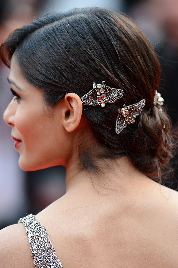 <strong>Take flight accessories</strong><br> Remember the humble butterfly clips you attached to all of your head? Of course you do… Hair accessories are still all that but the new version is all-grown-up. <br> <em>Celeb: Freida Pinto</em>