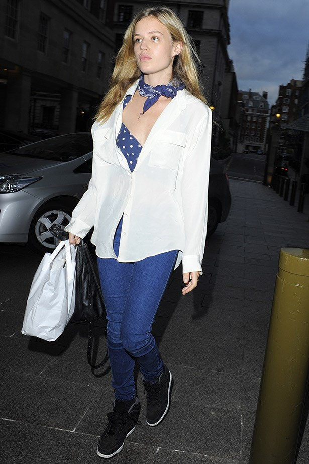 Georgia May Jagger – as always – looked too cool for school on an outing in London, using a scarf to dress up her casual ensemble.