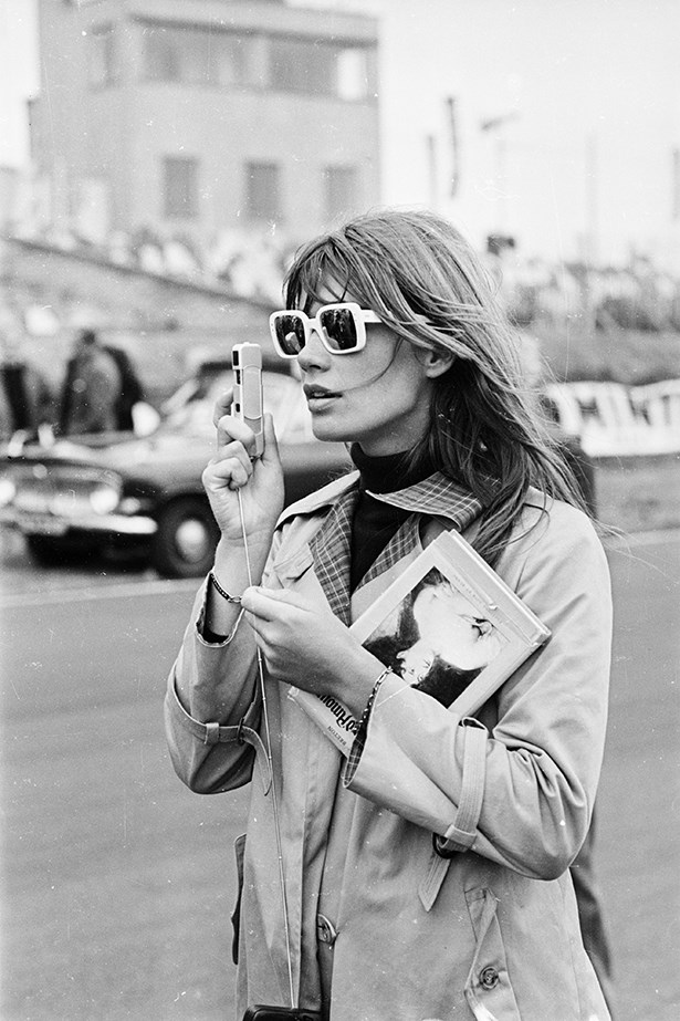 Francoise Hardy's mod skivvy under a classic trench is timeless. Replace the book with an iPad for a 21st-century update.