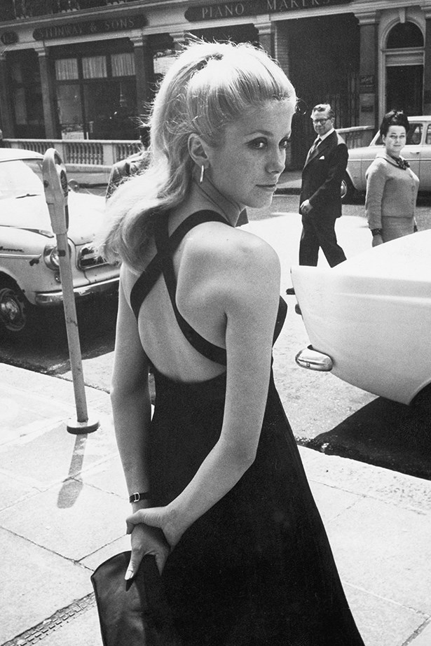 Catherine Deneuve in the ultimate checklist. Little black dress. Check. Practically effortless hairdo. Check. Understated clutch, fine earrings and cocktail watch. Check, check, check.