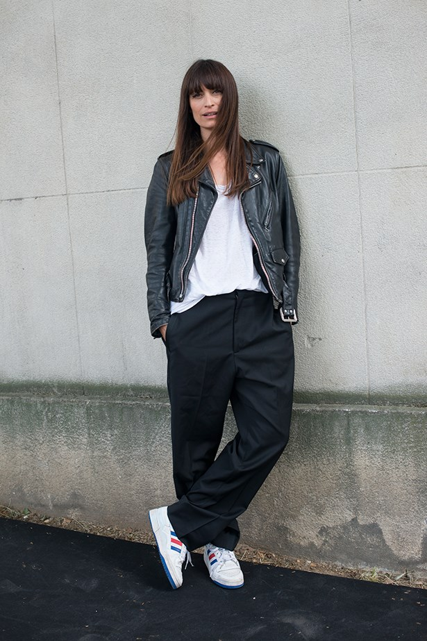 Caroline De Maigret slouches like she means it. Team trainers with tailored pants for an irreverent twist.