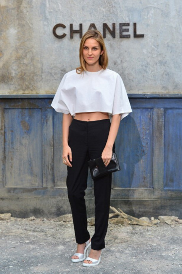 Gaia Repossi's well-judged flash of midriff instantly renders her look youthful and modern. Gym membership required.