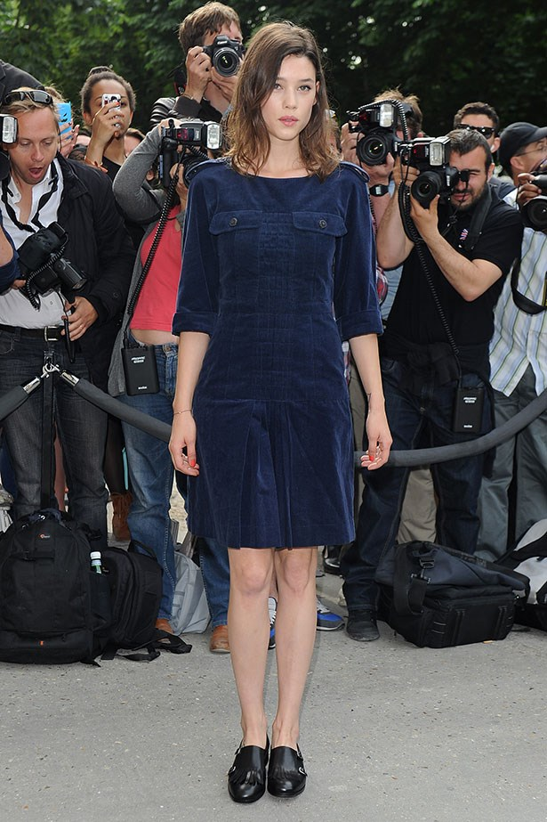 Astrid Bergès-Frisbey knocks the stuffing out of a prim schoolgirl dress with masculine loafers.