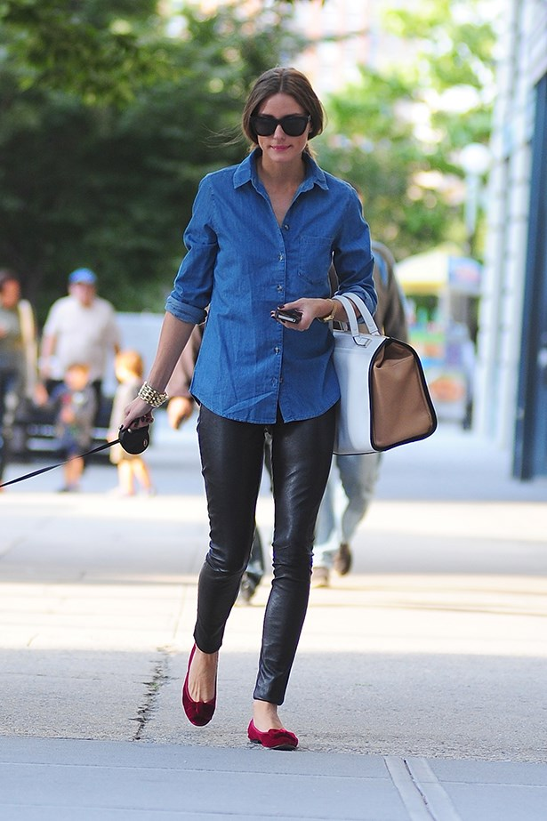 Olivia Palermo adds brightness to her outfit with a pair of red velvet ballet flats.