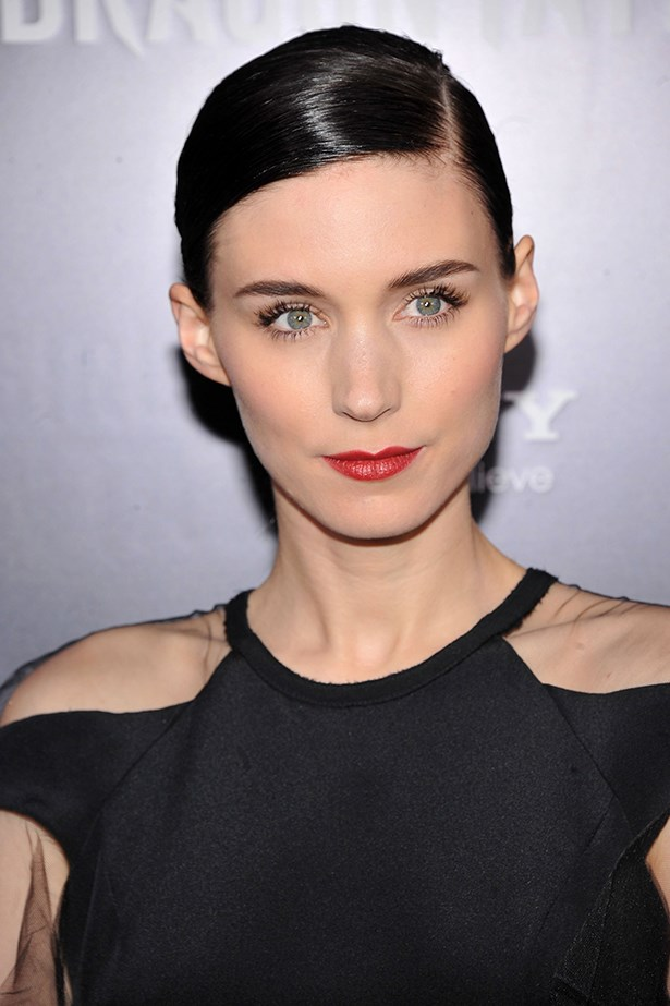 With a sleek side-part and red lips at the New York premiere in 2011 of her breakout role in <em>The Girl With A Dragon Tattoo</em>.