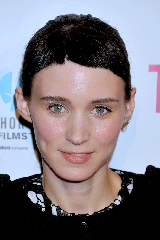 Sporting the signature blunt crop and brow ring for <em>The Girl With A Dragon Tattoo</em>, Mara softened the punk look with pretty pink lips and cheeks at the LA premiere of indie film <em>Tanner Hall </em>in 2011.