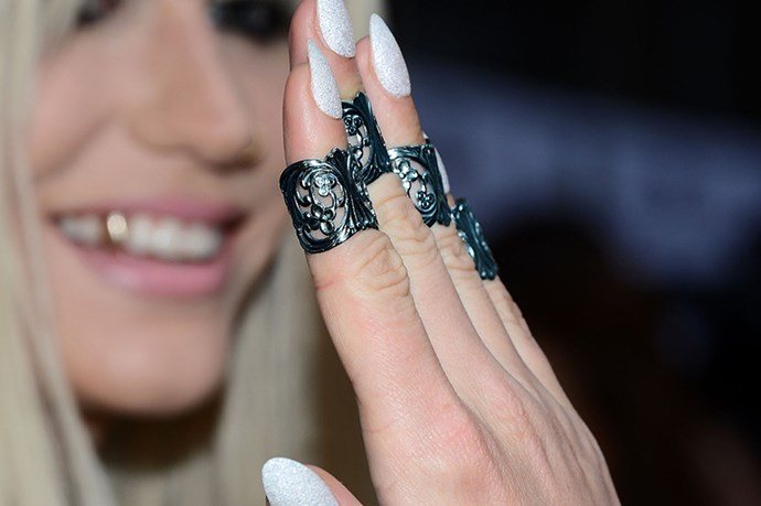 The always experimental Ke$ha hits on multiple nail trends at once with curved, white metallic nails – the best way to dabble in the look if white reminds you of liquid paper.