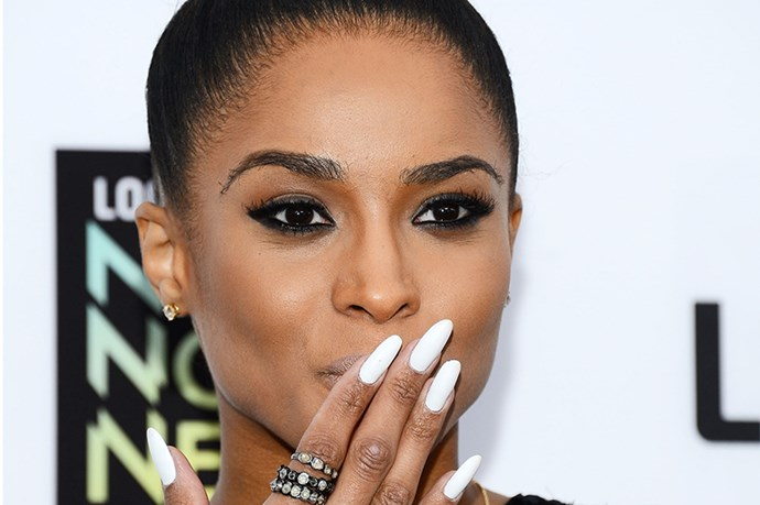 Ciara blows a white-hot kiss to fans in Los Angeles with long white nails.