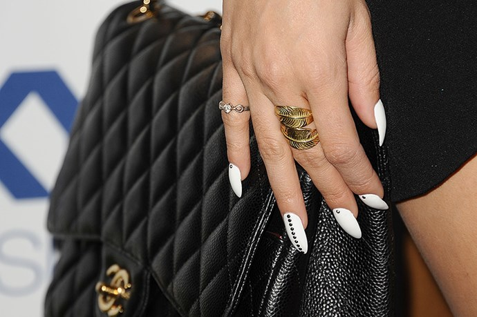 A grown-up Vanessa Hudgens combines white polish with studded nail art for a creative take on the neutral colour.