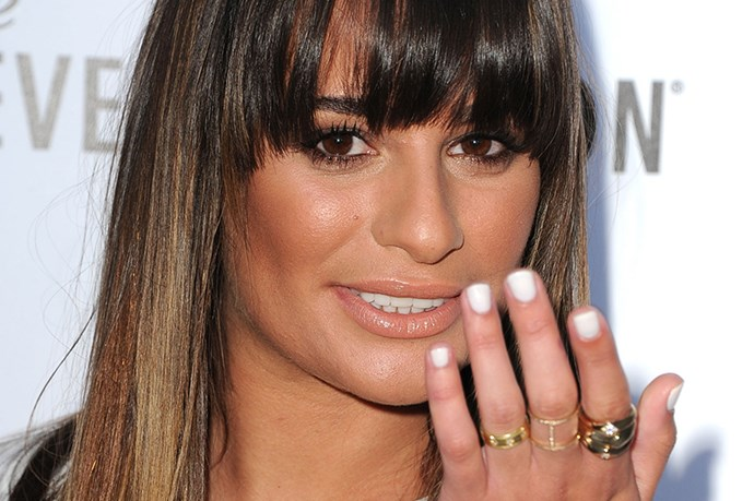 <em>Glee</em>'s Lea Michele pairs her blinding-white fingertips with a flattering golden glow and sparkling gold accessories.