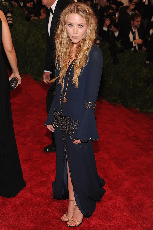 Mary-Kate Olsen adding an unexpected injection of vamp into her everyday folkloric attire.