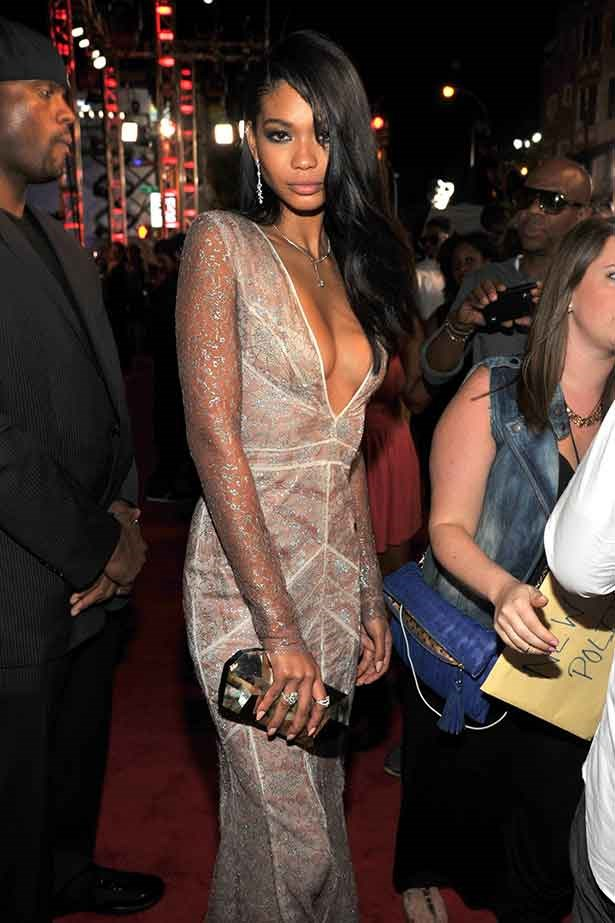 <strong>Molten lady</strong> <br> Model Chanel Iman smouldered in a silver lace panel gown and metallic box clutch at the MTV Video Music Awards.