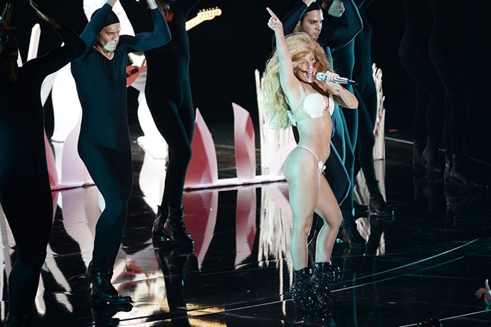 <strong>Gaga (almost) looked normal </strong> <P>Lady Gaga returned to the VMA stage after a two year absence, opening the show with a predictably-kooky performance of her new single <em>Applause,</em> wearing a long white smock and a block on her head. But just when we thought she may have toned things down when it comes to her sartorial choices, the 27-year-old whipped it all off to reveal a seashell bra and flower-festooned G-string. Which thankfully stayed on. </p>