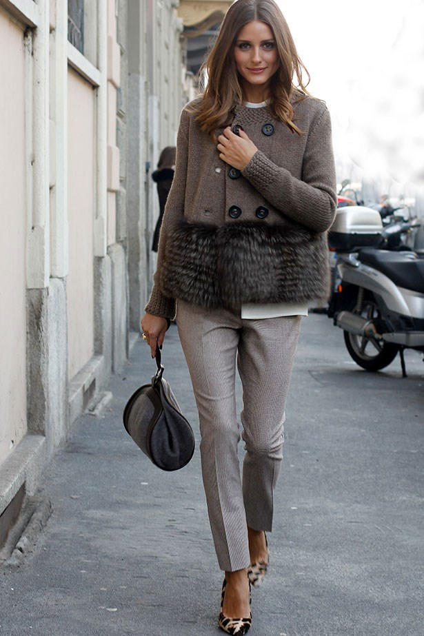 Olivia Palermo adds a hint of animal print to her stone-hued trousers and fur-trim Agnona jacket with leopard Mulberry pumps.