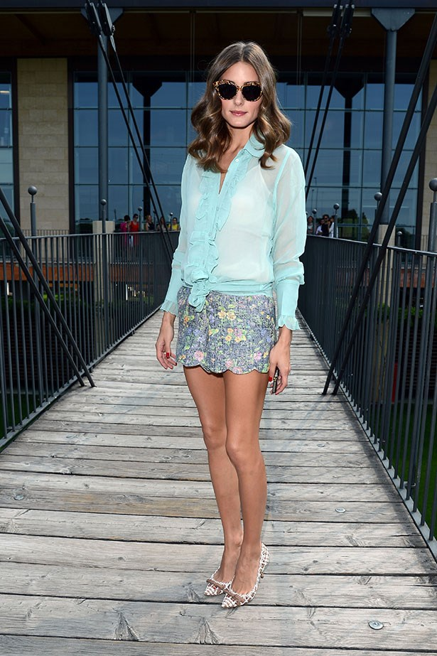 The fashion muse shows us how to perfect casual chic in a simple sheer turquoise blouse, scalloped-edge shorts and dainty pumps.