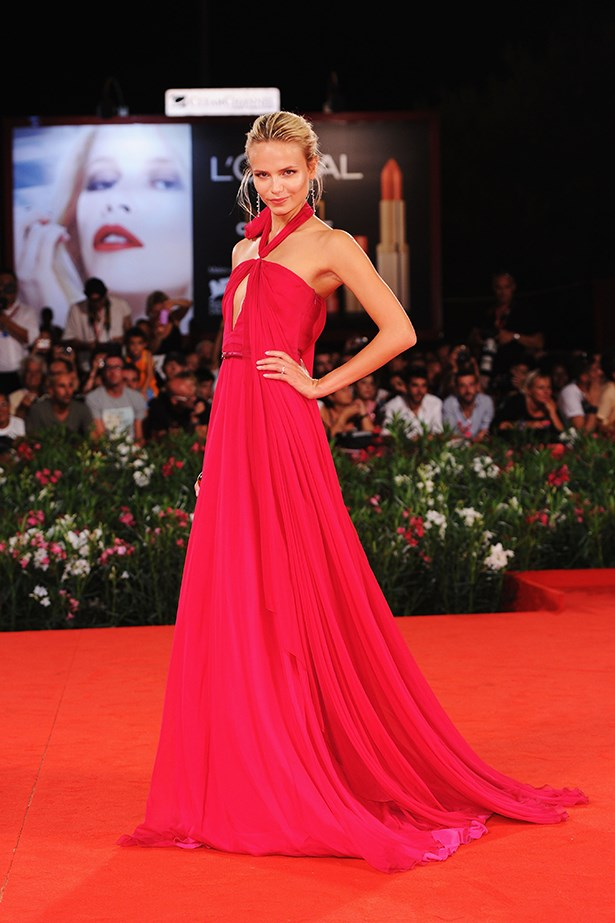 Natasha Poly proved her top-model status when she appeared on the red carpet in a fuchsia Gucci halter neck dress in 2011.