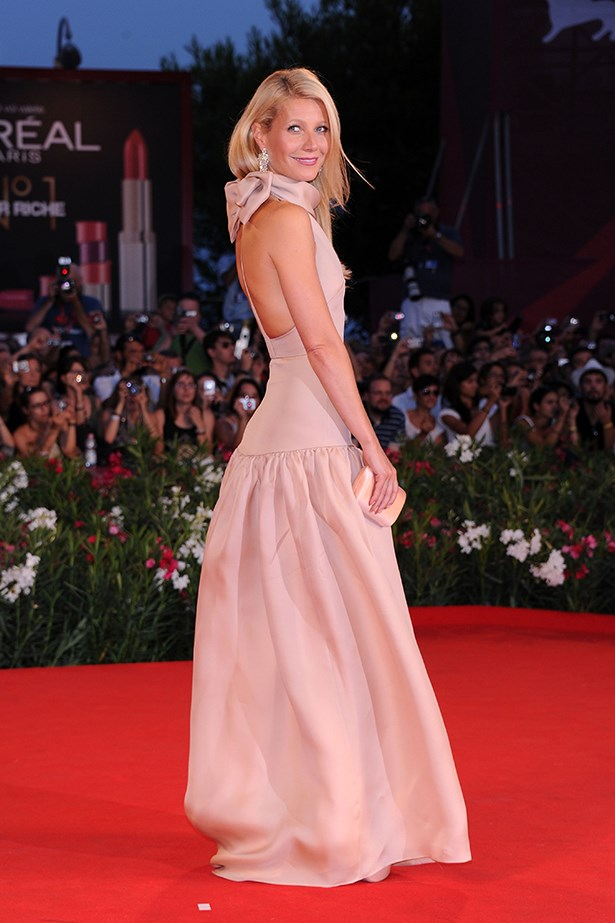 Gwyneth Paltrow looked radiant at the 2011 <em>Contagion</em> premiere in a pale pink Prada gown, complete with a feminine bow on the back.