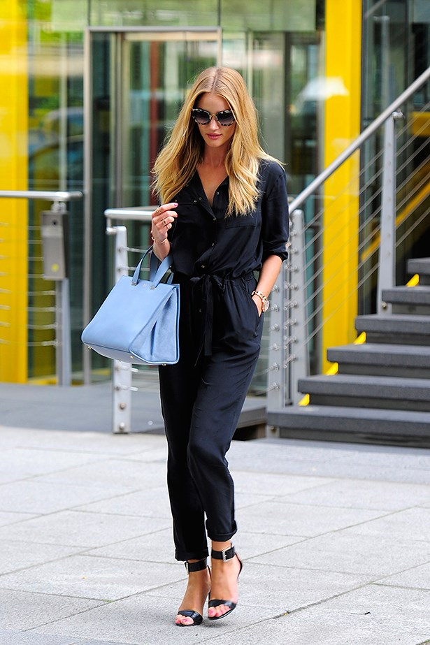 Rosie Huntington-Whiteley steps out in a black jumpsuit teamed with a baby-blue carryall.