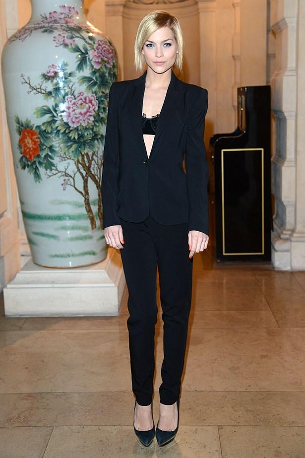 Leigh Lezark rocks a Le Smoking tuxedo and a showcase black bra underneath.