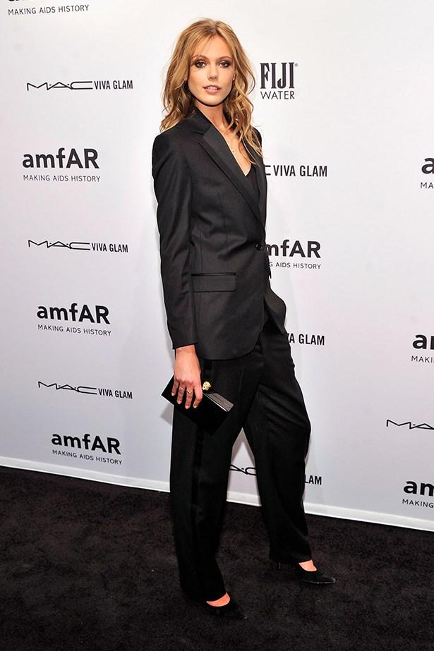 Frida Gustavsson wears an oversized black suit.
