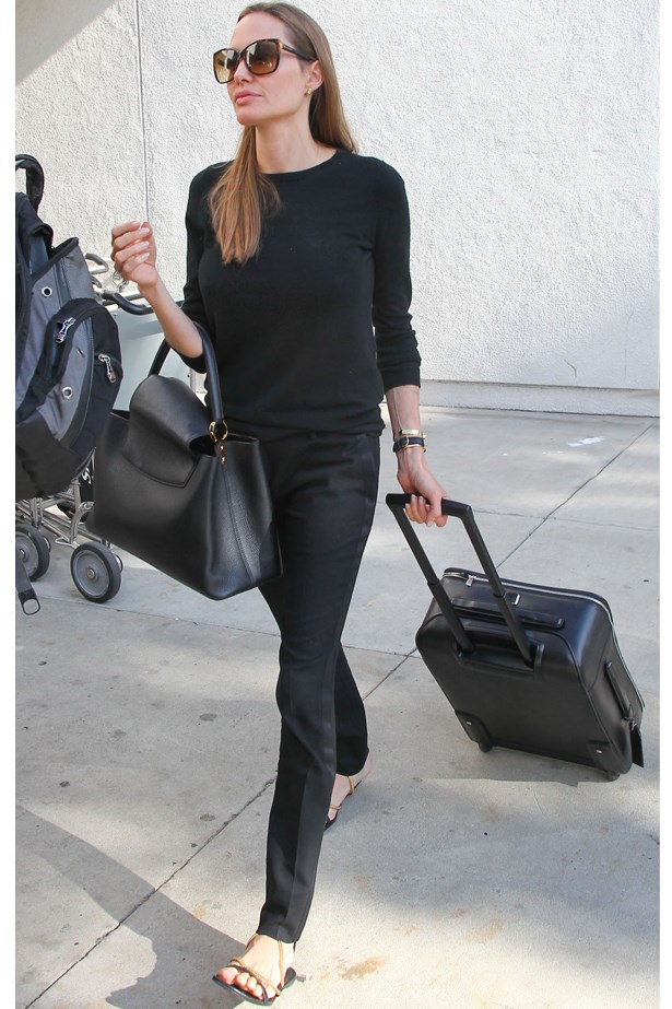 Angelina Jolie makes an airport-chic statement in black.