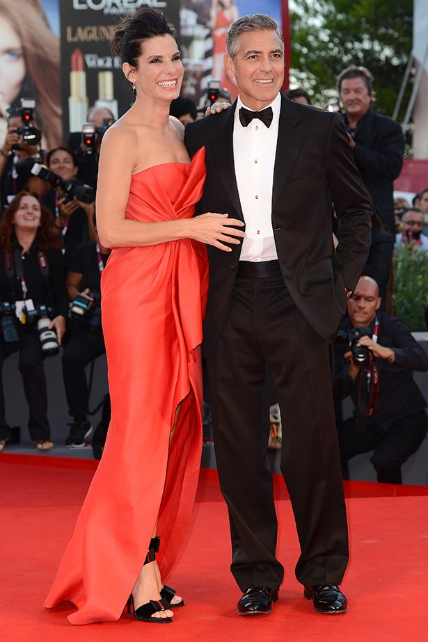 Sandra Bullock made a red-hot entrance in this J.Mendel Resort 14 gown. George Clooney proved to be the perfect accessory and looked exceptionally dapper in a Giorgio Armani tuxedo.