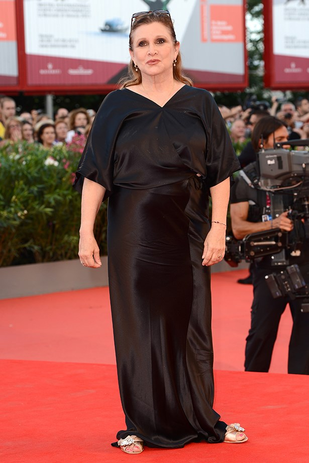 Carrie Fisher wore a classic black dress and offset the silk gown with a smokey eye.