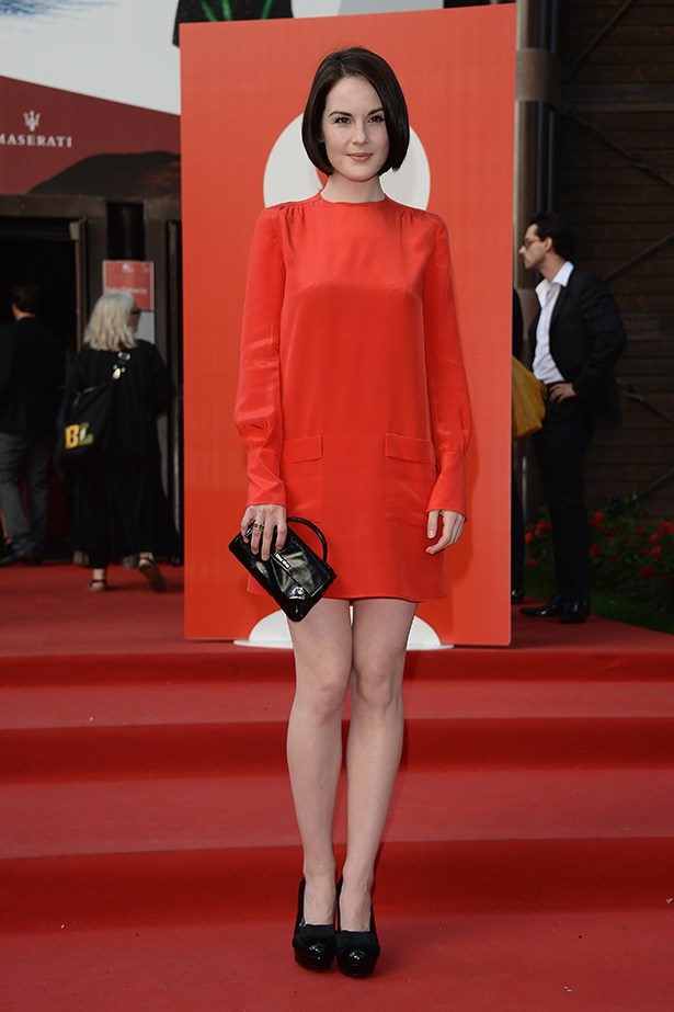 British actress, Michelle Dockery wore a Miu Miu shift dress with black patent Miu Miu accessories.