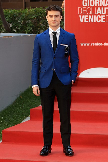 Actor Daniel Radcliffe looked surprisingly stylish in a pinstripe shirt paired with a cobalt blue David Hart suit.