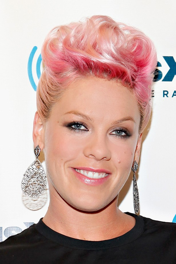 A pop of pink hair is combined with a glossy pink lip at a 2009 visit to Sirius XM Studio in New York.