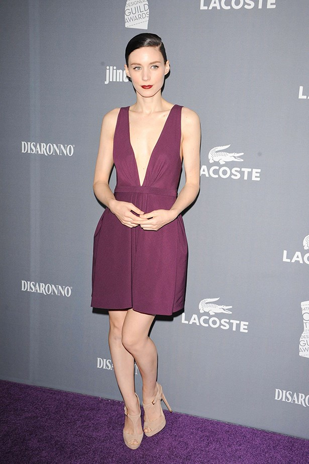 Subtle shoes and a neat up-do have rendered a risqué dress by J. Mendel elegant at the 14th Annual Costume Designers Guild Awards.