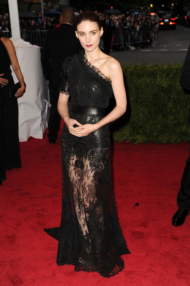 A one shoulder neckline and a sheer lace skirt gives light to this gothic-glam Givenchy Couture dress for the 'Schiaparelli And Prada: Impossible Conversations' gala event last year.