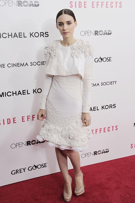 At the premier of Side Effects, an Alexander McQueen top and skirt set with embellished shoulders and ruffled hemline, combined with a slick middle part, have us thinking Spanish senorita.