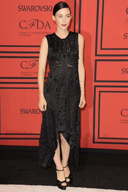 The 2013 CFDA Fashion Awards is the perfect place to exhibit a classic black dress by Calvin Klein - simple yet chic with a classic pair of black heels.