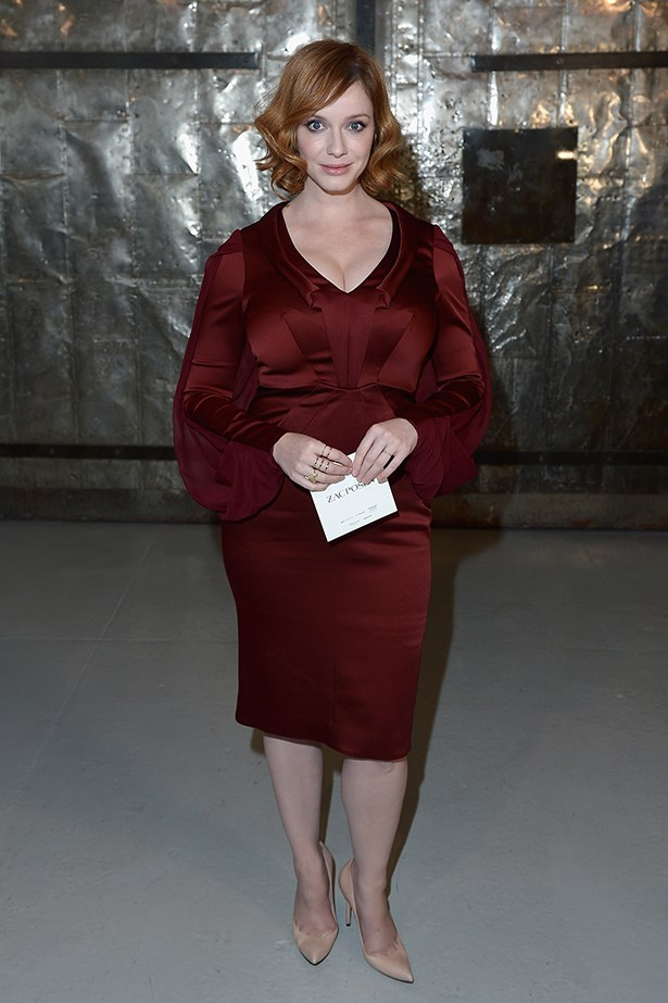 Christina Hendricks looks absolutely flawless in a red satin gown while attending Zac Posen's fashion show.