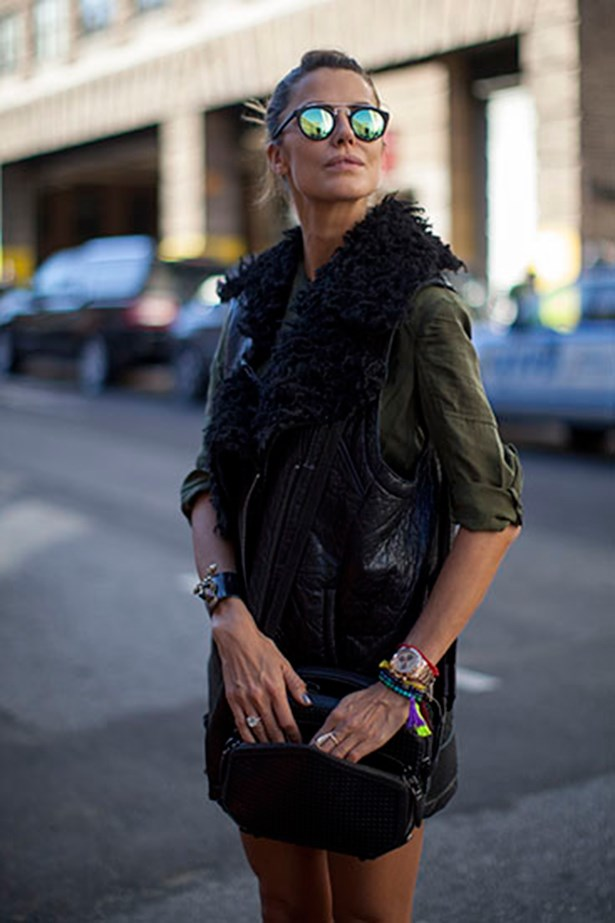 This New York Fashion Week guest adds a touch of colour to a khaki and black outfit with dazzling blue-green shades.