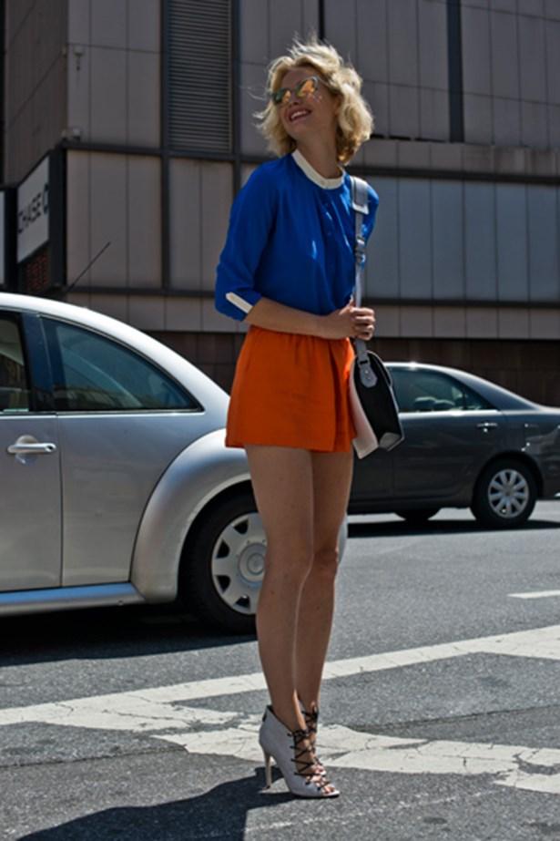Local blogger Zanita Morgan completes her colour-blocked look with winged orange Prada sunglasses.